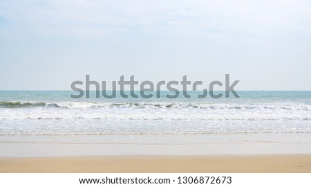 landscape of natural yellow sand on  beach on blue clear sky background at summer has white air bubble or foam with blue water wave and copy space can use as vacation weekend backdrop on nobody place