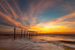 landscape of old wooden bridge with colorful sky in twilight time at Khok Kloi, Takua Thung District, Phang-nga, Thailand.