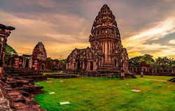 Landscape of Phimai Historical Park with sunset sky. Landmark of Nakhon Ratchasima, Thailand. Travel destinations. Historic site is ancient. Ancient building. Khmer temple classical architecture.