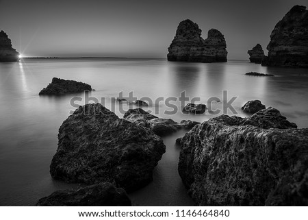 landscape of Portugal , beach and rocks in the sunset