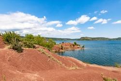 Landscape of red rocks of Lake Salagou (Occitanie, France)