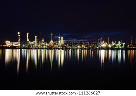 Landscape of river and oil refinery factory after sunset time in Chao praya river, Bangkok, Thailand.