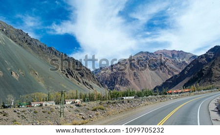Landscape of  road in the hight mountains from region Mendoza in Argentina to Chile near Los Polvorines area. Abandoned  Transandine Railway (or Ferrocarril Trasandino).  #1099705232