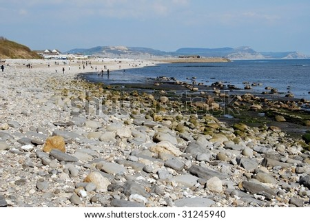 Landscape of rocky beach with pebbles at Lyme Regis, Dorset, South West England