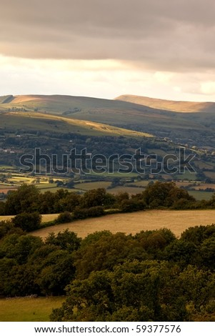 Landscape of rolling hills in Brecon Beacons National park by sunset before rain in Wales, UK