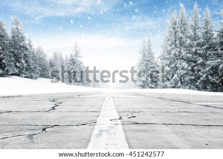 landscape of sky and trees of snow and gray road  stock photo
