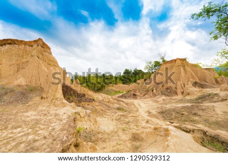 "landscape of soil textures eroded sandstone pillars, columns and cliffs, natural erosion of water and wind, ""Sao Din Na Noi""or ""Hom Chom"" and ""Khok Suea"" at sri nan national park in Nan Province #1290529312"