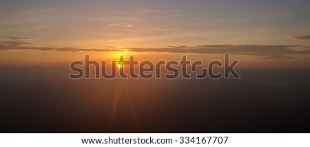 Landscape of sunrise flare lighting and mountain at Phu ruea national park, Loei -Thailand