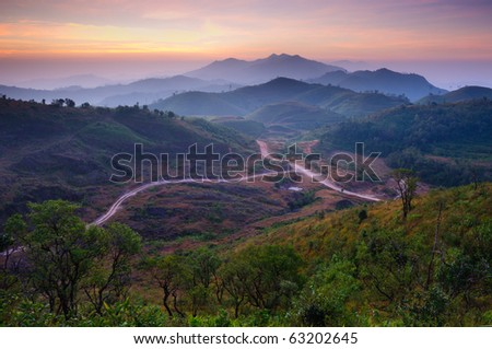 Landscape of sunrise over mountains in Kanchanaburi,Thailand