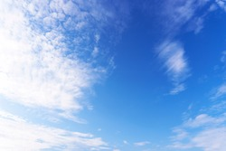 Landscape of the blue sky with clouds in the afternoon day with natural sunlight over the creativity ideas on the abstract background, refer to the hope and freedom of the future