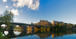 Landscape of the city of Barcelos, district Braga, Portugal. Landscape on the river Cavado, Barcelos bridge, Paco dos Condes, water mill and church. Buildings all in stone and old with lots of history