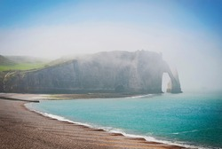 Landscape of the city of Etretat , the cliffs and Bay in the fog. Etretat, France