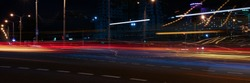 Landscape of the city of Minsk in Belarus blurred lights of car headlamps in the motion of the window lighting in the evening