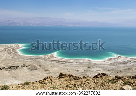 stock photo landscape of the dead sea failures of the soil and the strong shallowing of the sea illustrating 392277802 - Каталог — Фотообои «Море, пляж»