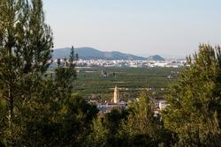 Landscape of the La Safor region of Valencia (Spain) with views of the bell tower and the town of L 'Alqueria de la Comtessa.