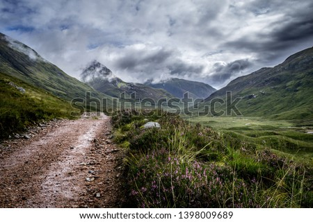 Landscape of the Scottish Highlands on a stormy day, showing the route of the West Highland Way National Trail - Scotland. #1398009689