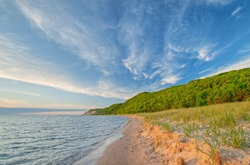 Landscape of the shoreline of Lake Michigan with beautiful clouds near sunset, Sleeping Bear Dunes National Lakeshore, Michigan, USA