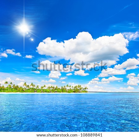 landscape of tropical island beach with palm trees and sunny blue sky holidays background