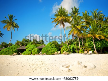 landscape of tropical island beach with perfect cloudy blue sky