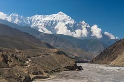 Landscape of Upper Mustang with Nilgiri mountain peak, Himalaya mountains range in Nepal, Asia