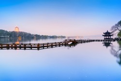 Landscape of West Lake. Long Bridge and Leifeng Pagoda. Located in Hangzhou City, Jiangsu Province, China.
