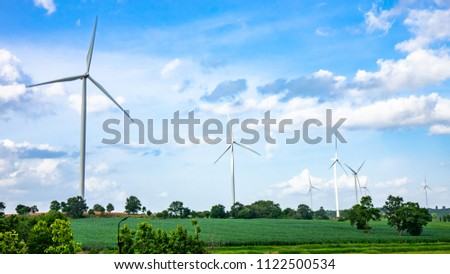 Landscape of wind turbine in the corn field concept of clean power industry