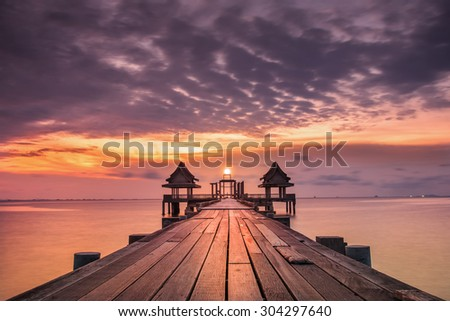 Landscape of Wooded bridge in the port between sunrise