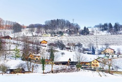 Landscape on countryside in Switzerland in winter. Switzerland is a country in Europe. Switzerland has a high mountain range; from the Alps to Jura mountains.