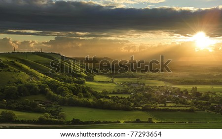 Stock Photo Landscape over English countryside landscape in Summer sunset