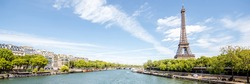 Landscape panoramic view on the Eiffel tower and Seine river during the sunny day in Paris