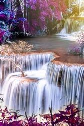 Landscape photo Amazing waterfall in wonderful autumn forest, beautiful waterfall in rainforest
