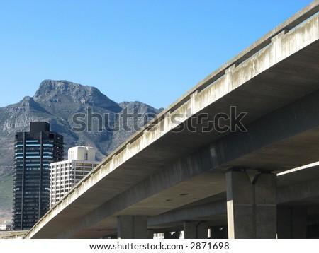 Landscape photo of a concrete overpass leading into Cape Town