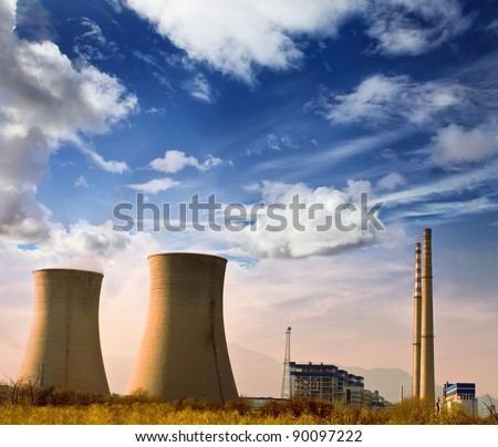 Landscape photo of industrial factory with power chimneys in blue sky in rural area