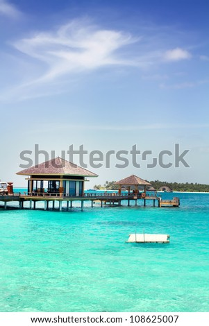 Landscape photo of Island in ocean, overwater villa with endless swimming pools. Maldives. #108625007