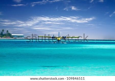 Landscape photo of Sea plane taking off in ocean