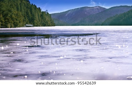 Landscape photo of Treking route along beautiful ice lake in Shangri-La Mountain area in China