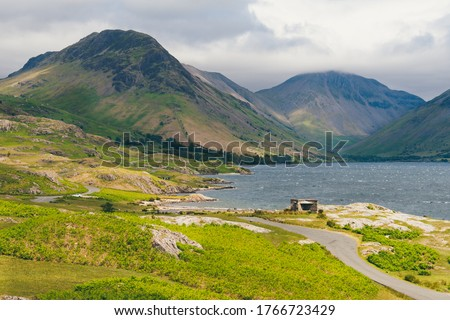 Photo of  Landscape photo of Wast Water in the Lake District Natinal Park with Great Gable Moutain in the background and the winding country road over the fells leading to Great Gable.