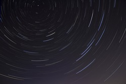 Landscape Photograph of Star Trails at Night Sky.