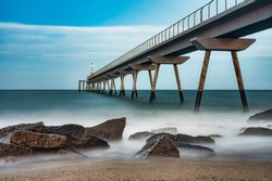 Landscape photography with an old industrial bridge that juts out into the sea