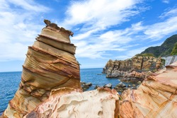 Landscape photos of Nanya Rocka, sandstone sea stack, cross stratum, coral-eroded shore with a striped appearance from oxidation, Ruifang District, New Taipei City, Taiwan,