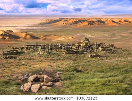Landscape plateau Ustyurt in Kazakhstan. With overlooking the ruins of the ancient Muslim cemetery.