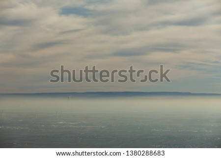 Landscape Rhine plain with windmills under a fog cover and cloud cover #1380288683
