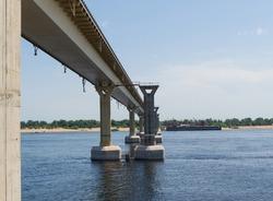 Landscape, river and bridge pillars, water reflections