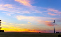 Landscape scenery, Sunset sky with condensation trail. Texture of bright evening sky during sunset. Dramatic blue and orange, colorful clouds at twilight time. Abstract weather nature concept