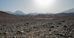 Landscape scenic view of desolate barren rocky eastern desert in Egypt with mountains