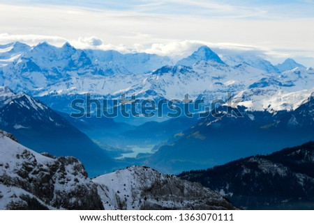 Landscape seen from the top of Mount Pilatus in autumn - Distance view of Berner Alps and Lake Lungern, Canton of Obwalden / Nidwalden / Lucerne, Central Switzerland, Switzerland #1363070111