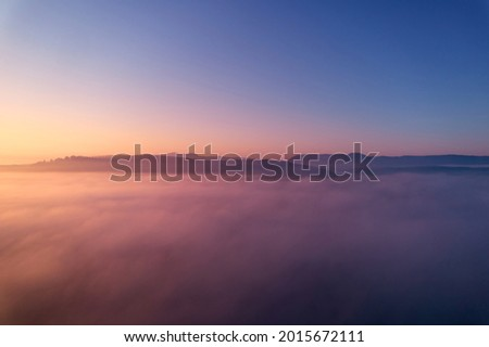 Landscape shot above the fog. Hill panorama of swabian alb on the horizon. Blue sky for copy space. Aerial view. Imagine de stoc ©