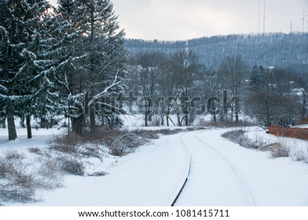 Landscape shot of rail track covered in snow.  #1081415711