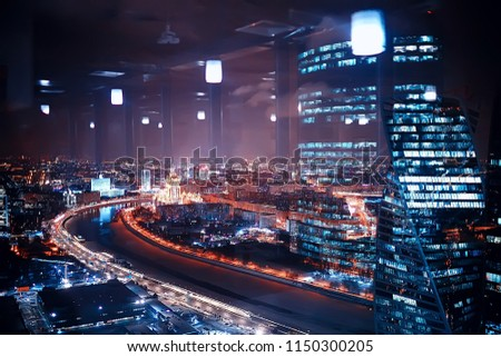 landscape skyscrapers night / business center in a night landscape, winter lights in the windows of houses in the business district