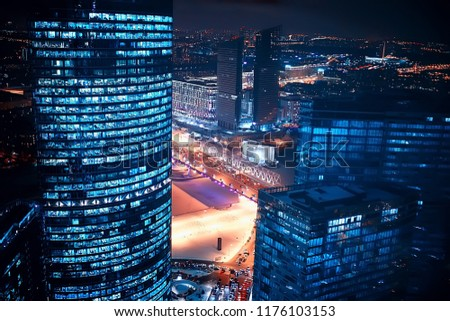 landscape skyscrapers night / business center in a night landscape, winter lights in the windows of houses in the business district #1176103153